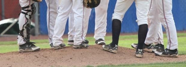 Baseball-gathering-on-the-mound_vert